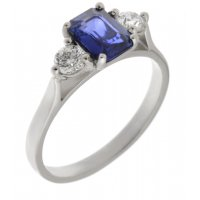 Olivia emerald cut blue sapphire and round diamond trilogy ring