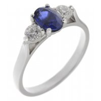 Olivia oval shape blue sapphire and round brilliant cut diamond trilogy ring