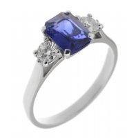 Rosaline emerald cut blue sapphire and round diamond trilogy ring