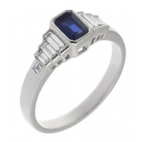 Art deco rubover emerald cut blue sapphire and baguette diamond ring