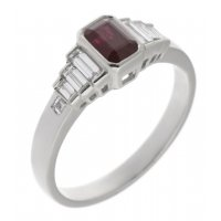 Art deco rubover emerald cut ruby and baguette diamond ring