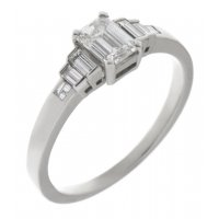 Art deco emerald cut and baguette diamond engagement ring
