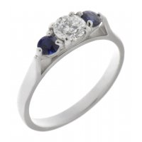 Olivia classic round brilliant cut diamond and round blue sapphire trilogy ring