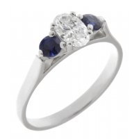 Olivia classic oval shape diamond and round blue sapphire trilogy ring