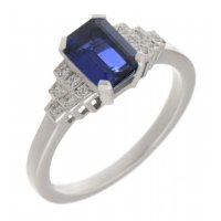 Deco step emerald cut blue sapphire and round diamond ring