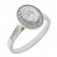 Classic rubover set oval diamond with round diamond halo engagement ring