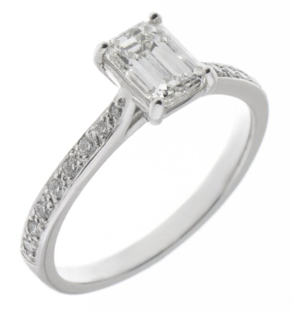 Kiss style Emerald cut diamond solitaire engagement ring with grain set diamond shoulders