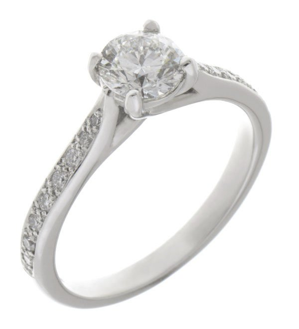Kiss style round diamond solitaire engagement ring with grain set diamond shoulders