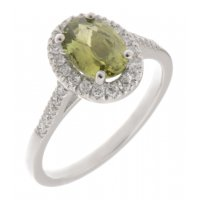 Classic claw set oval green sapphire with round diamond halo ring
