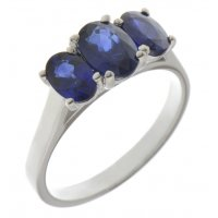 Classic oval blue sapphire trilogy ring