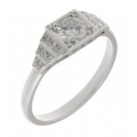 Chrysler art deco style round brilliant cut diamond engagement ring