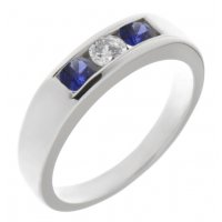Classic channel set round brilliant cut diamond centre and blue sapphire trilogy ring