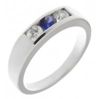 Classic channel set round blue sapphire centre and brilliant cut diamond trilogy ring