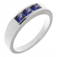 Classic channel set round blue sapphire trilogy ring