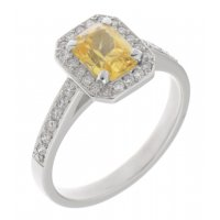 Classic claw set emerald cut yellow sapphire and diamond halo cluster ring