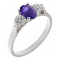 Olivia oval shape tanzanite and round brilliant cut diamond trilogy ring