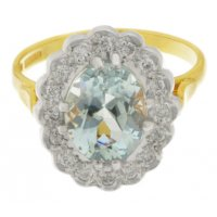 Classic oval Aquamarine and Diamond halo cluster ring