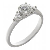 Classic round brilliant cut diamond engagement ring with pear shape side stones