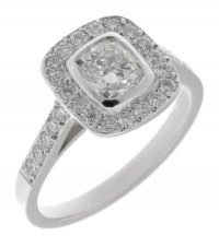 Classic cushion cut diamond rubover halo engagement ring